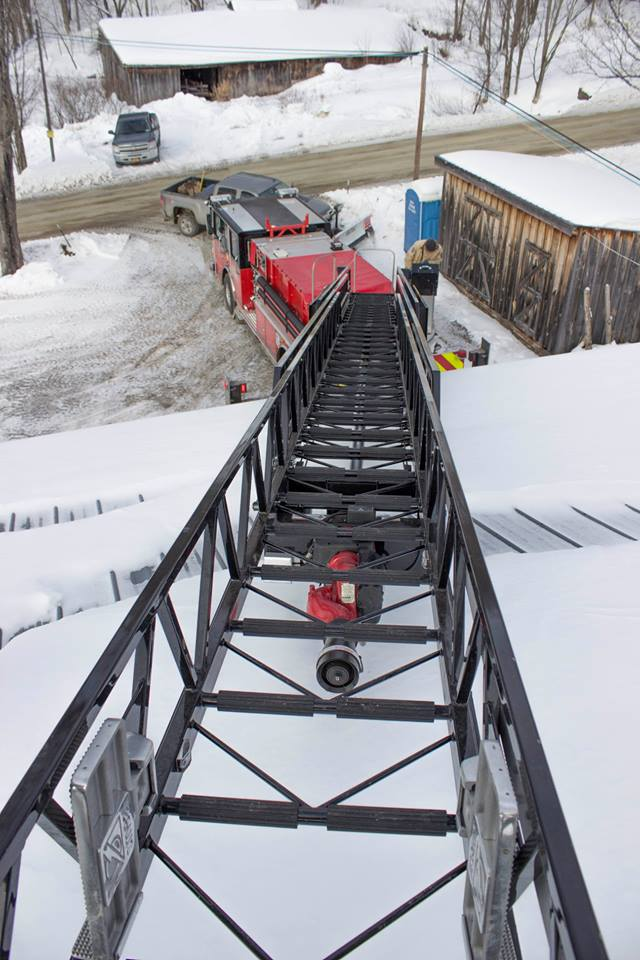 looking down ladder onto truck